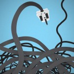 an electrical plug and wires against a blue background